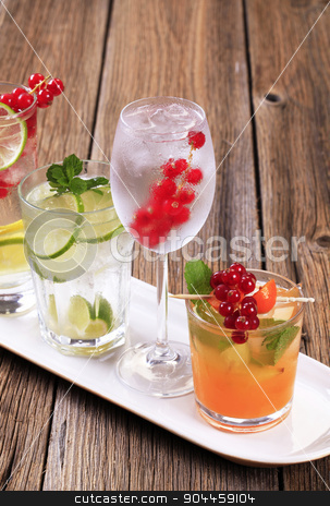 Variety of iced drinks stock photo, Glasses of iced drinks garnished with fresh fruit by Digifoodstock