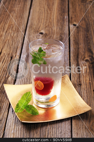 Cranberry juice cocktail stock photo, Shot of cranberry juice in a glass of vodka by Digifoodstock