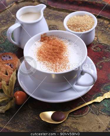 Coffee time stock photo, Cup of milk streamer with nutmeg and  brown sugar by Digifoodstock