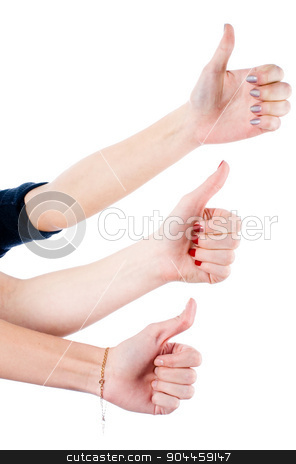Girls with ok gesture stock photo, Young women showing ok sign (thumb up) by Aikon
