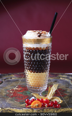 Liqueur coffee with whipped cream stock photo, Liqueur coffee with whipped cream in a tall glass by Digifoodstock