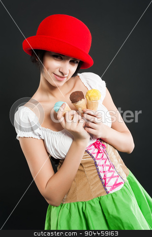 Pretty girl in german style with ice cream stock photo, Beautiful woman in german beer girl costume with ice cream at black background by Aikon