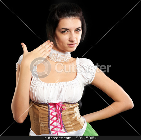 Pretty girl in german style stock photo, Beautiful woman in german beer girl costume. Isolated on black by Aikon