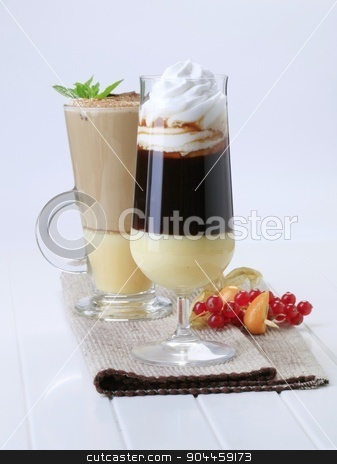 Coffee drinks stock photo, Two coffee drinks in tall glasses - still life by Digifoodstock
