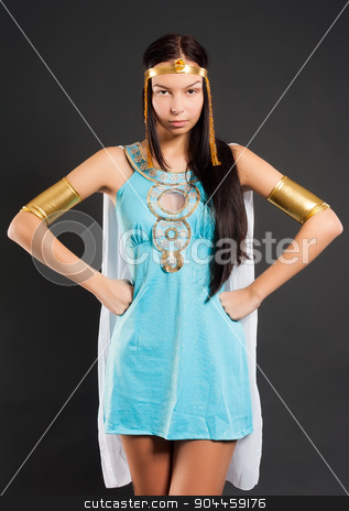 Pretty girl in Cleopatra role stock photo, Beautiful woman in egyptian queen costume at black background by Aikon