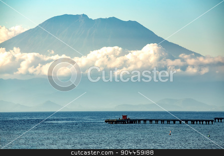 view on Bali from ocean, vulcano in clouds stock photo, beautifull view on Bali from ocean, nusa penida island, vulcano in clouds with blue ocean and sky by Artush