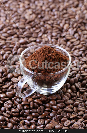 Ground coffee stock photo, Freshly ground coffee in a glass cup  by Digifoodstock