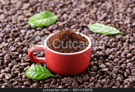 Ground coffee stock photo, Freshly ground coffee in a red cup by Digifoodstock