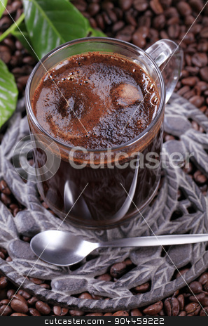 Turkish coffee stock photo, Turkish coffee on a cast iron coaster by Digifoodstock