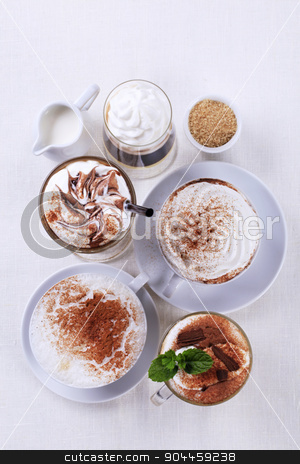Coffee drinks stock photo, Variety of coffee and chocolate drinks - overhead by Digifoodstock