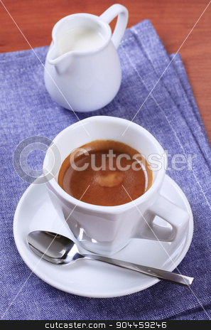 Cup of coffee stock photo, Cup of coffee and jug of milk  by Digifoodstock
