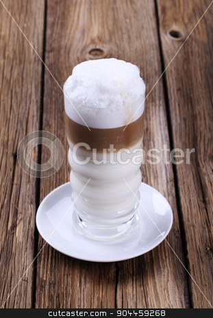 Latte macchiato stock photo, Glass of Latte macchiato with milk foam  by Digifoodstock