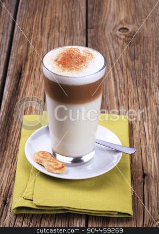Latte macchiato stock photo, Glass of Latte macchiato with a dusting of nutmeg  by Digifoodstock