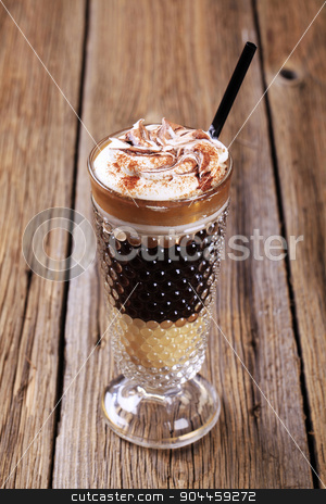Coffee drink stock photo, Coffee drink topped with whipped cream and mutmeg by Digifoodstock