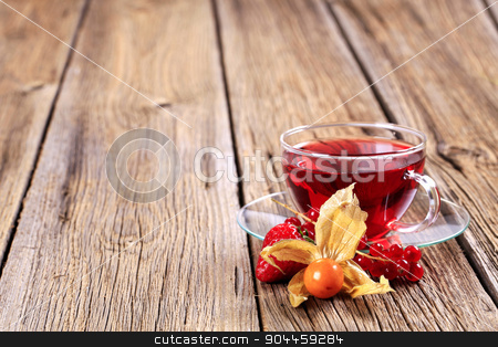 Fruit tea  stock photo, Fruit tea in a glass cup - closeup by Digifoodstock