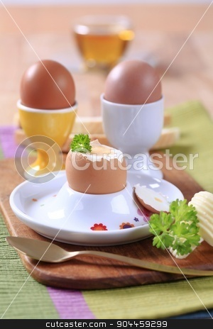 Boiled eggs stock photo, Boiled eggs in porcelain egg cups by Digifoodstock
