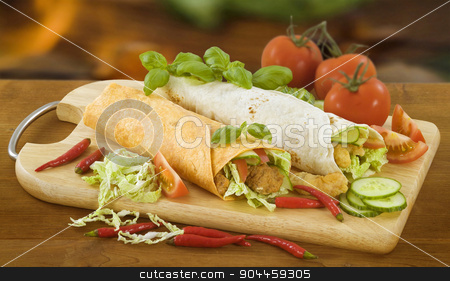 Two tortilla wraps  stock photo, Two chicken and vegetable tortilla wraps  by Digifoodstock