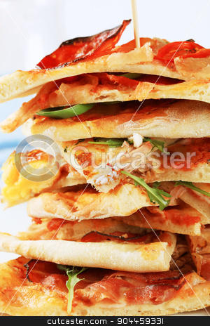 Slices of pizza  stock photo, Stack of thin slices of pizza - detail by Digifoodstock