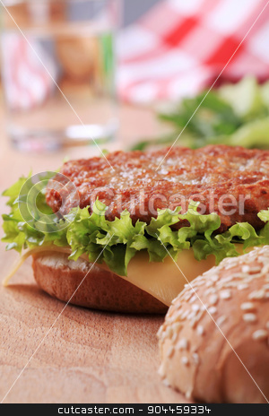 Hamburger  stock photo, Closeup of a Cheeseburger - ready to eat by Digifoodstock