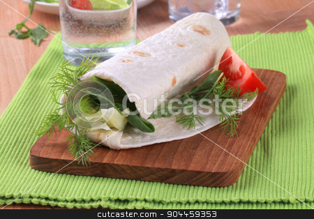 Vegan wrap sandwich stock photo, Tortilla folded around a vegetable filling  by Digifoodstock