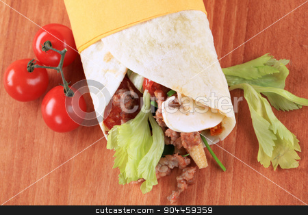 Wrap sandwich  stock photo, Tortilla filled with ground meat - closeup by Digifoodstock