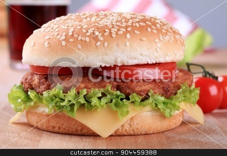 Cheeseburger stock photo, Detail view of a tasty cheese burger by Digifoodstock
