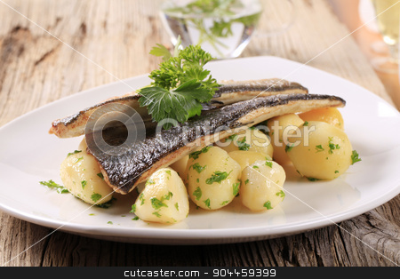 Pan fried trout fillets with potatoes stock photo, Pan fried trout with potatoes by Digifoodstock