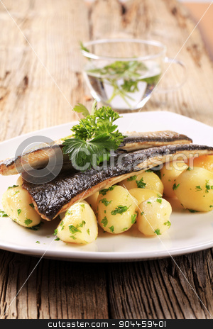 Pan fried trout with potatoes stock photo, Pan fried trout with potatoes by Digifoodstock