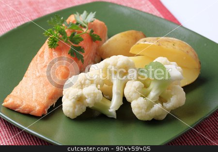 Salmon fillet and vegetables stock photo, Oven-baked salmon fillet, potatoes and cauliflower by Digifoodstock