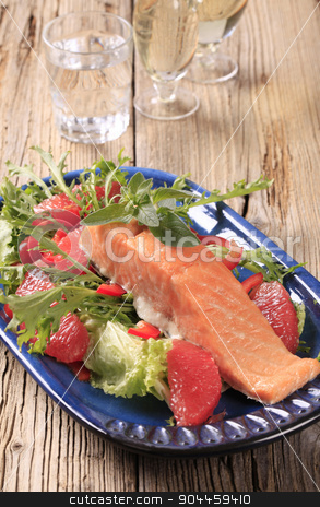 Seared salmon with salad greens and red orange stock photo, Salmon fillet on a bed of fresh salad  by Digifoodstock