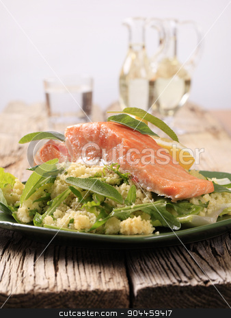 Salmon fillet with couscous salad stock photo, Slow roasted salmon fillet on a bed of couscous salad  by Digifoodstock