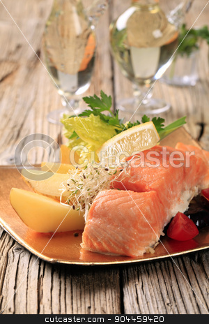 Salmon fillet and potatoes stock photo, Salmon fillet served with potatoes and vegetable garnish by Digifoodstock