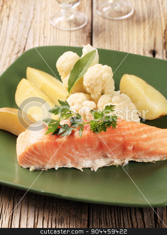 Salmon fillet and potatoes  stock photo, Salmon fillet served with potatoes and cauliflower  by Digifoodstock