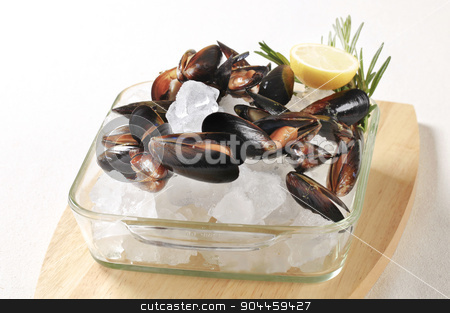 Raw mussels on ice stock photo, Raw mussels and lemon on ice by Digifoodstock