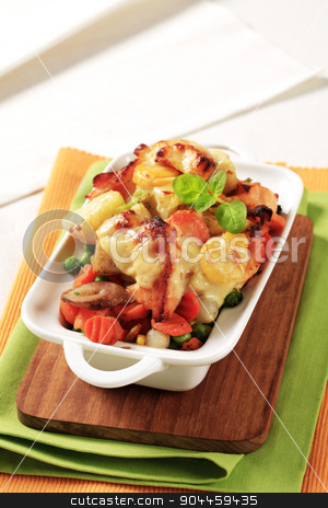Fish and vegetable casserole stock photo, Fish and vegetable casserole topped with cheese by Digifoodstock