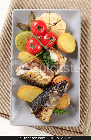 Crispy spiced mackerel with potatoes stock photo, Pieces of crispy spiced mackerel with new potatoes by Digifoodstock