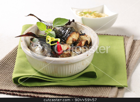 Baked mackerel stock photo, Pieces of baked mackerel in a casserole dish by Digifoodstock