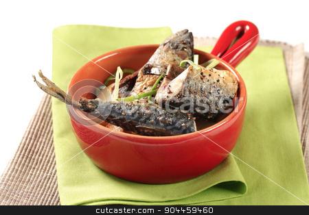 Spiced mackerel with potatoes stock photo, Spiced mackerel with roasted potatoes in a red pan by Digifoodstock