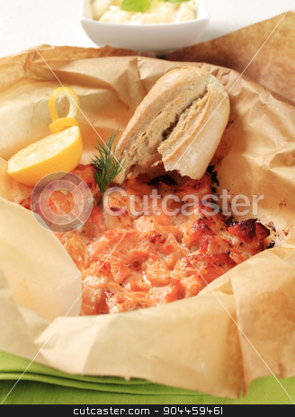 Salmon appetizer stock photo, Oven baked chopped salmon and bread roll by Digifoodstock