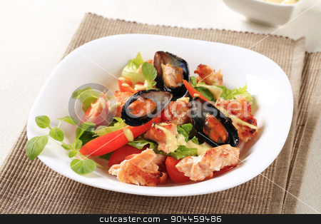 Seafood salad  stock photo, Seafood salad with pan fried salmon and mussels by Digifoodstock