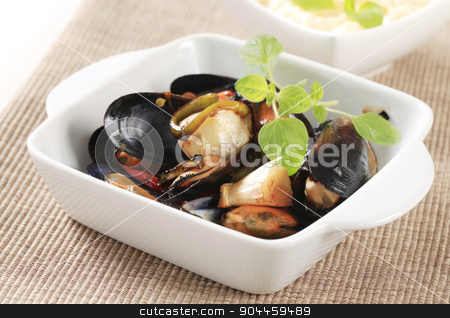 Steamed mussels stock photo, Delicious steamed mussels in a ceramic dish by Digifoodstock