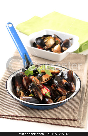 Steamed mussels stock photo, Delicious steamed mussels in a frying pan by Digifoodstock