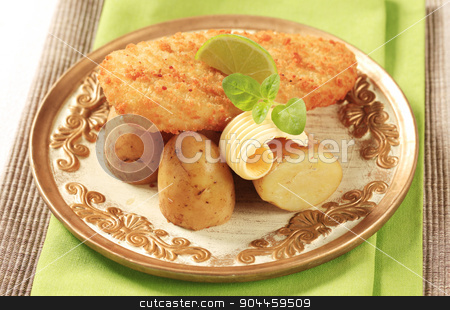 Fried fish with new potatoes stock photo, Fried fish fillet served with new potatoes  by Digifoodstock