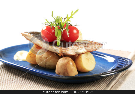 Pan fried fish with new potatoes stock photo, Pan fried fish fillet served with new potatoes  by Digifoodstock