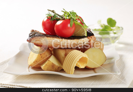 Pan fried trout and potatoes stock photo, Pan fried trout served with new potatoes  by Digifoodstock
