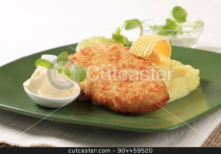 Fried fish and mashed potato stock photo, Fried breaded fish served with mashed potato by Digifoodstock