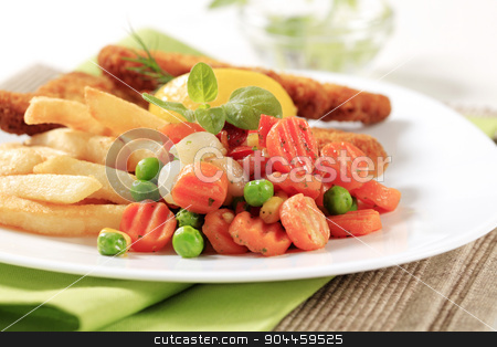 Mixed vegetables and French fries stock photo, Side dish of mixed vegetables and French fries  by Digifoodstock