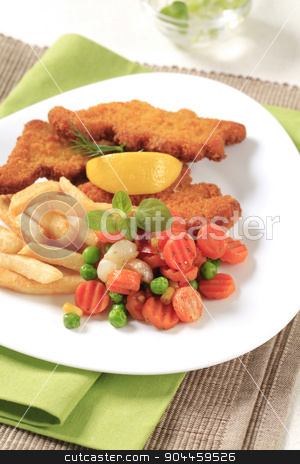 Fried fish and French fries stock photo, Fried fish served with French fries and mixed vegetables by Digifoodstock