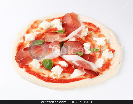 Pizza proscuitto    stock photo, Raw pizza dough with mozzarella and proscuitto on top by Digifoodstock