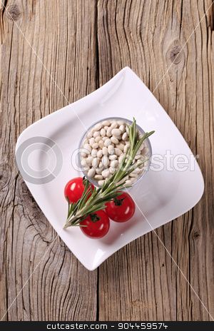 White beans stock photo, Raw beans, tomatoes and rosemary - still life by Digifoodstock